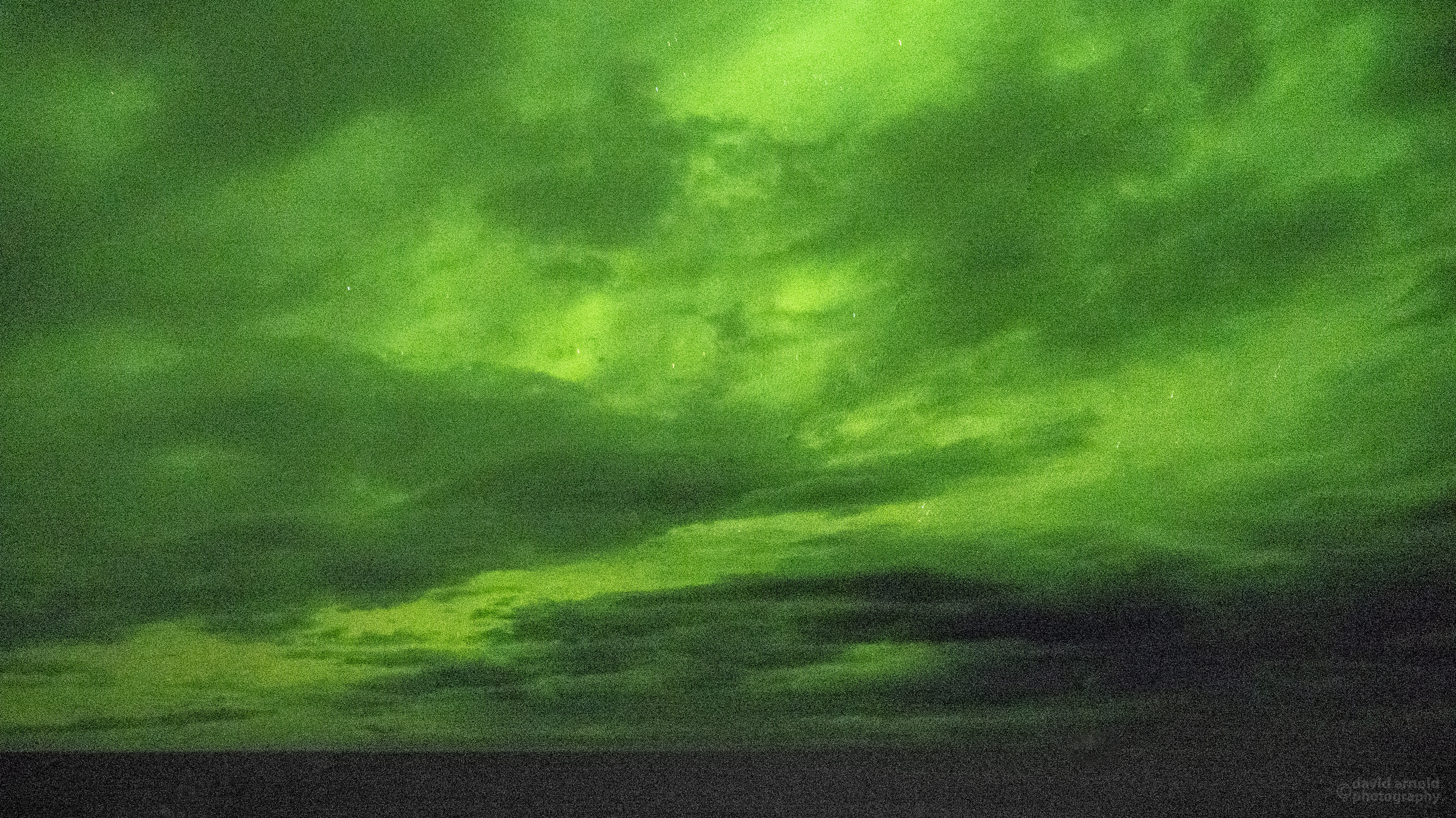 Northern Lights through heavy cloud cover from the upper deck of the MS Trollfjord
