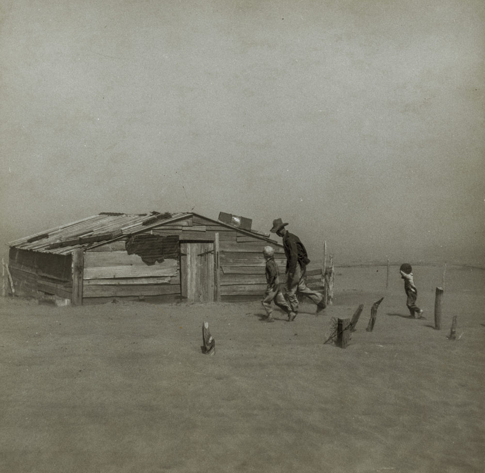 Arthur Rothstein, Farmer and sons walking in the face of a dust storm. Cimarron County, Oklahoma.