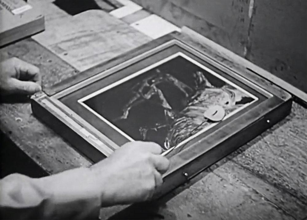 Edward Weston dodging a black and white print.