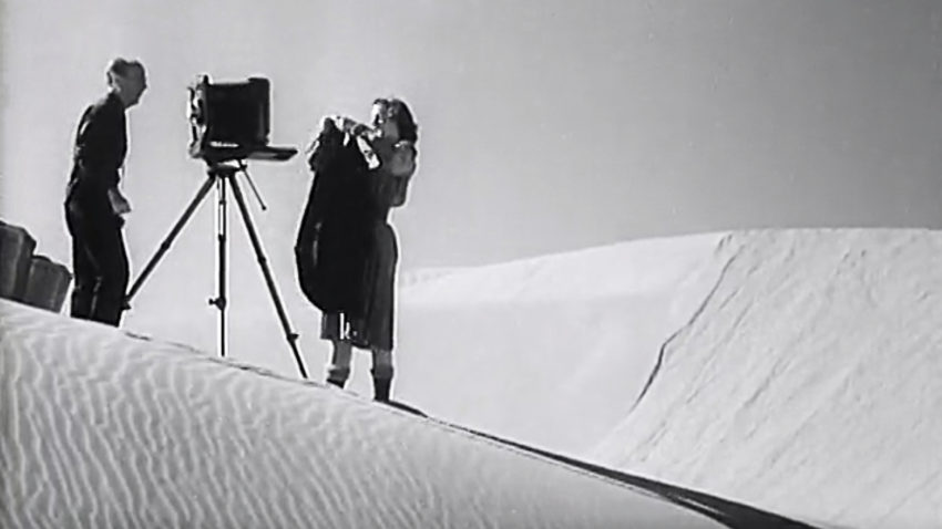 Edward Weston setting up his view camera on the Oceano Dunes, California